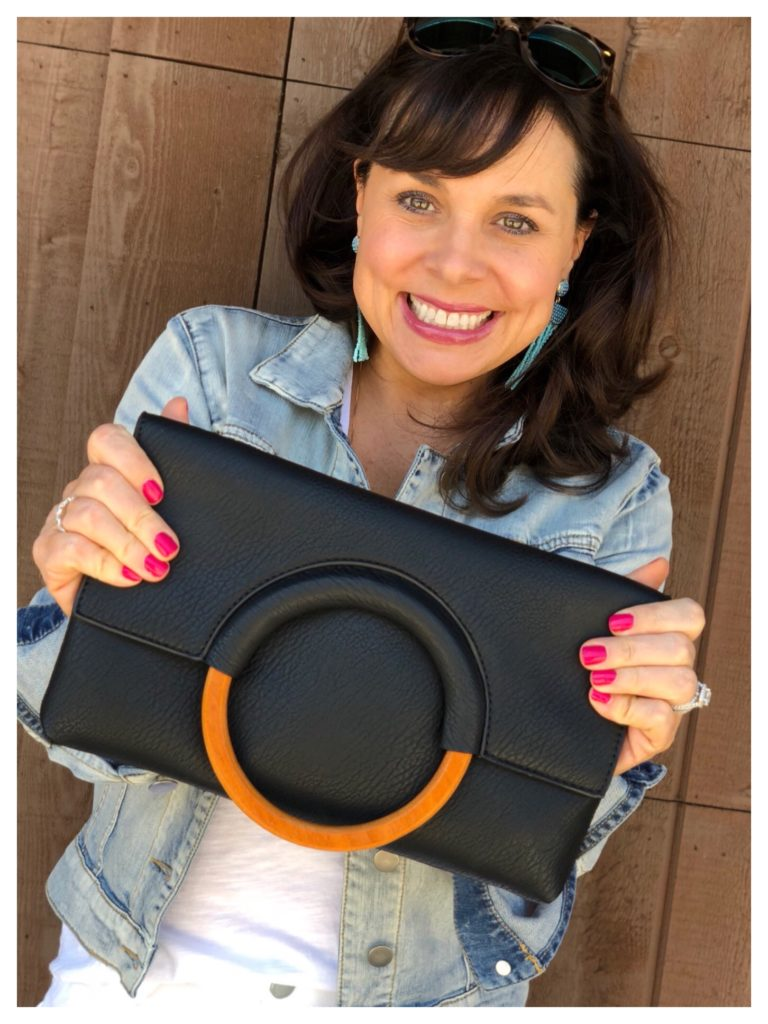 black clutch with wooden ring
