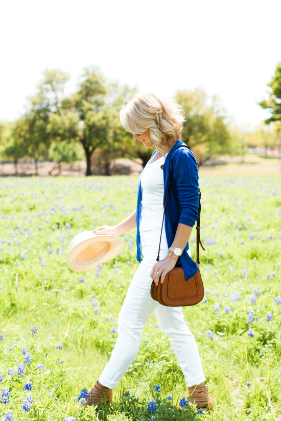 white jeans outfit in bluebonnet texas field photography