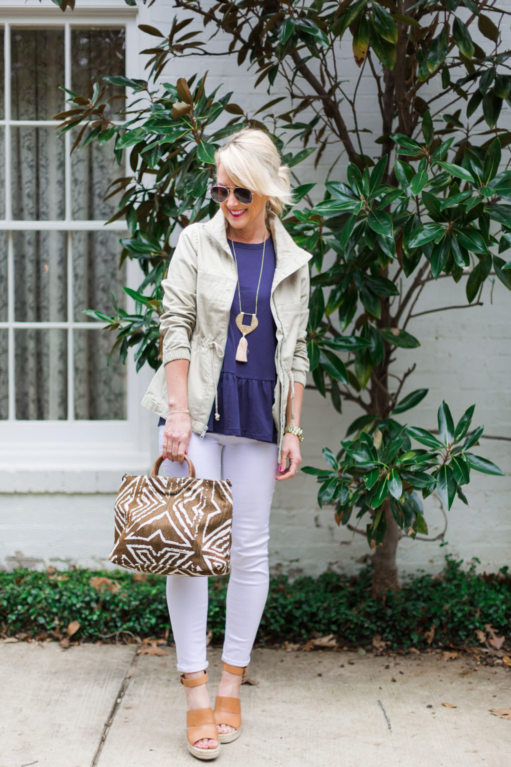 spring outfit idea white jeans and jacket for layering