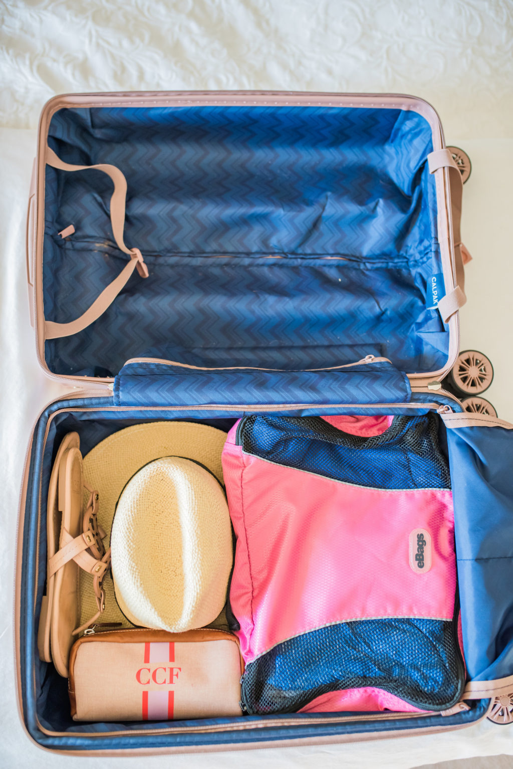 how to pack a hat in a small carry on suitcase with ebags